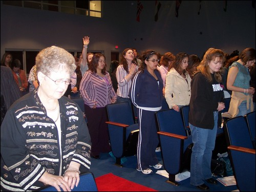 Women line up at Faith Builders International Style Ministry