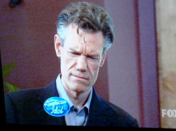 Randy Travis doesn't see dudes with nail polish very often