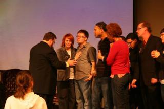Pastor Pruitt lays his hand on Danny Gokey