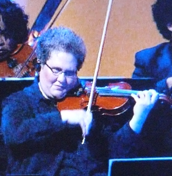 "Viola chick in Idol string section looks like Phyllis from ""The Office"""