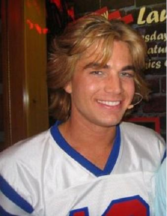 Adam Lambert: Blond Hair and athletic jersey