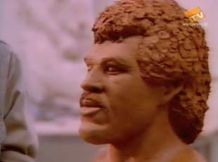 Lionel Richie's sculpted head in Hello