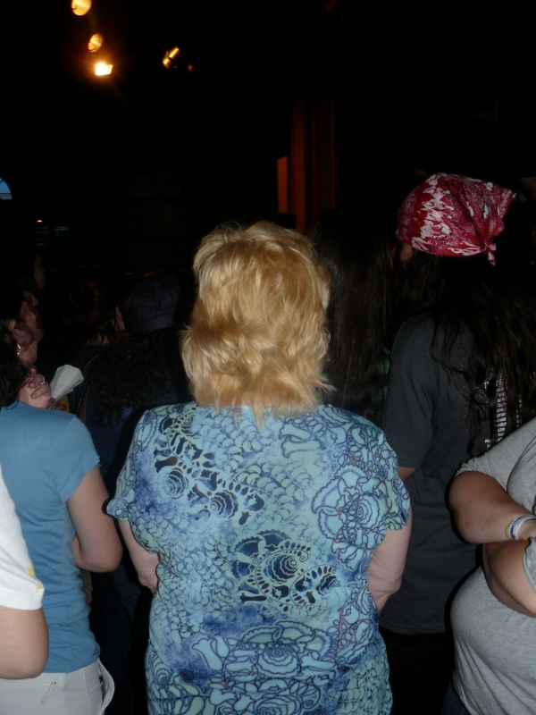 Some dumb bitch who can't handle people standing near her at a David Cook show