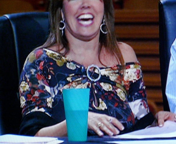 Is Mary Murphy drinking water or vodka?