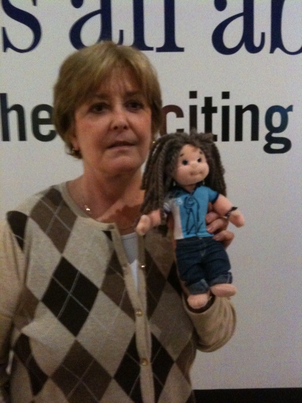 Woman and her Jason Castro doll